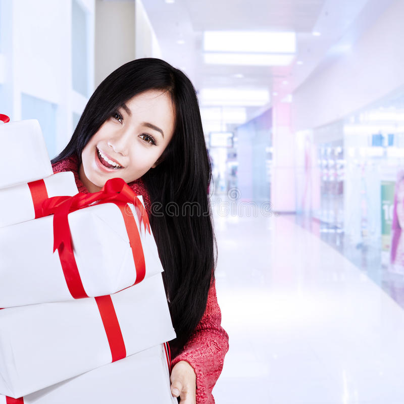 Attractive female shopper bring boxes at mall vector illustration