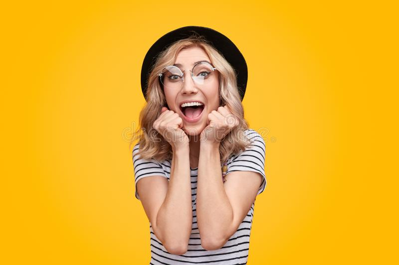 Excited woman screaming and looking at camera royalty free stock image