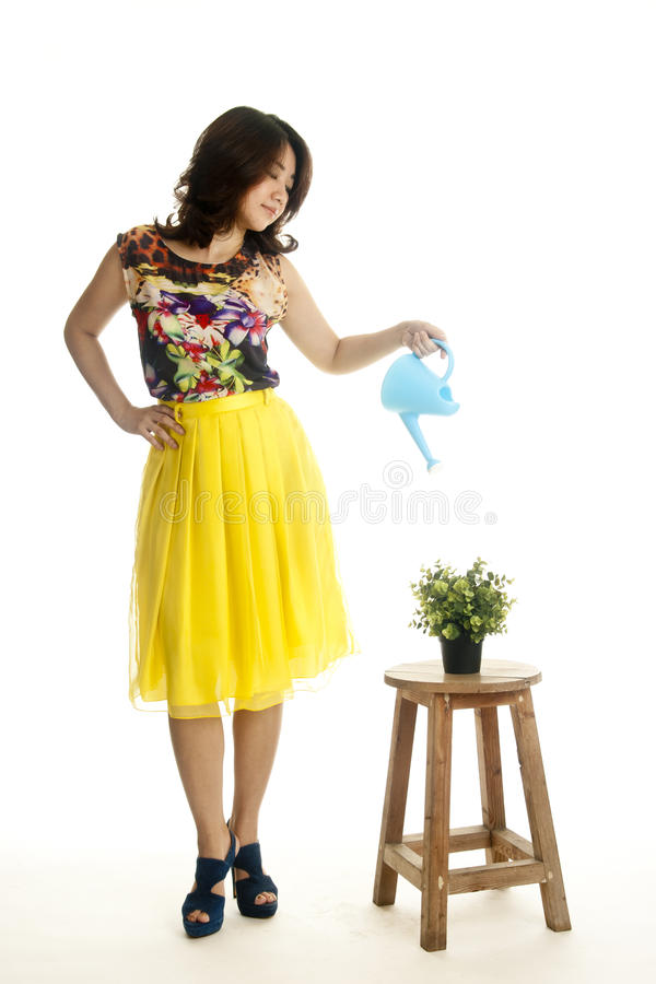 Download Attractive Female With A Watering Can Stock Photography - Image: 25253422