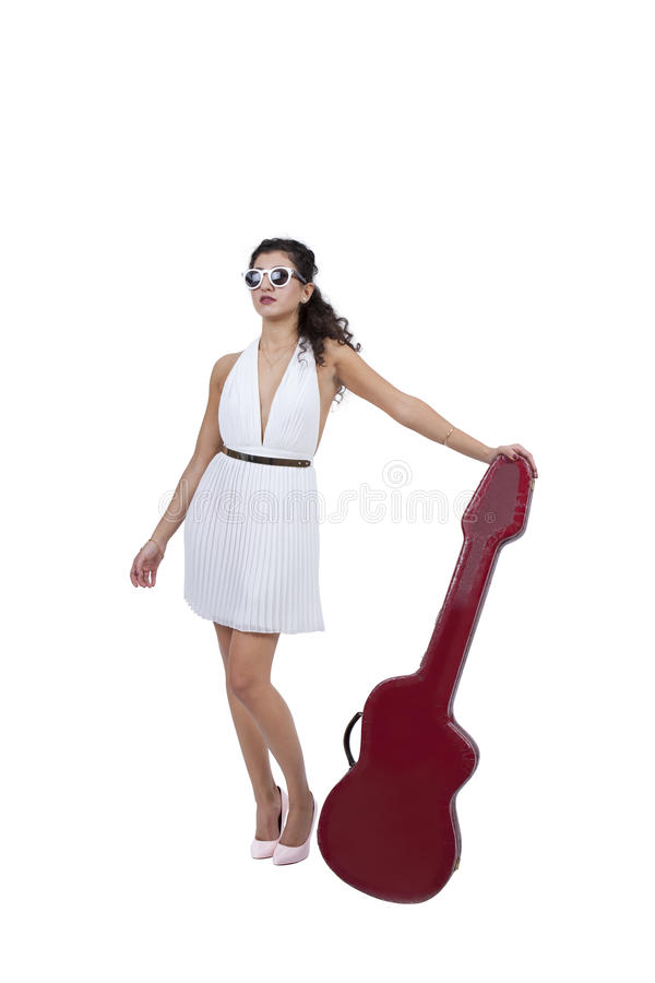 Attractive female wearing sunglasses posing with guitar stock image