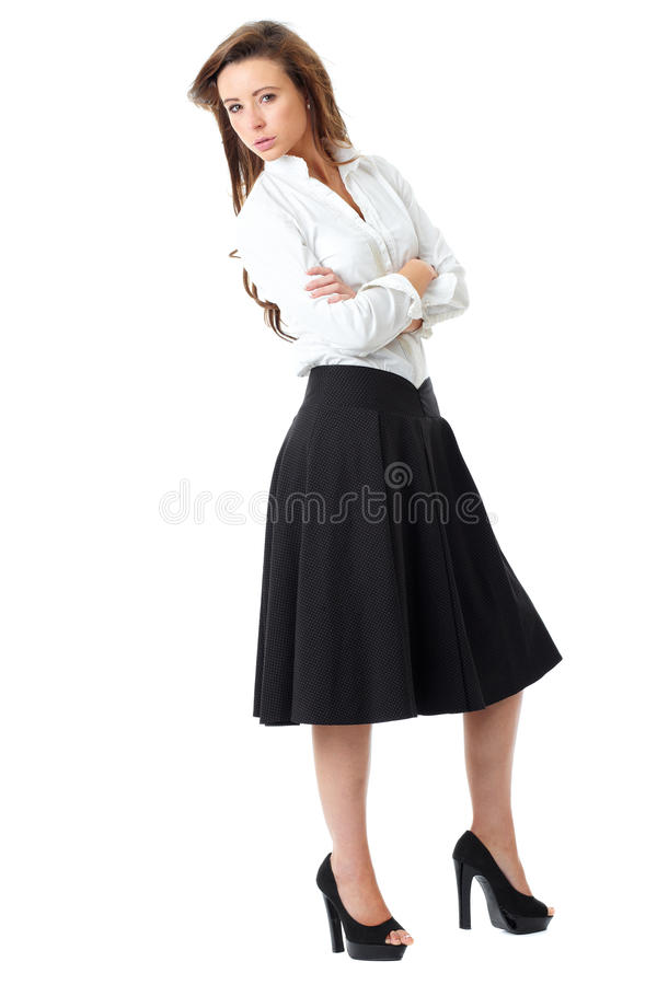 Attractive female in white shirt and black skirt. Young atractive female in white shirt and black skirt pose over white background stock images