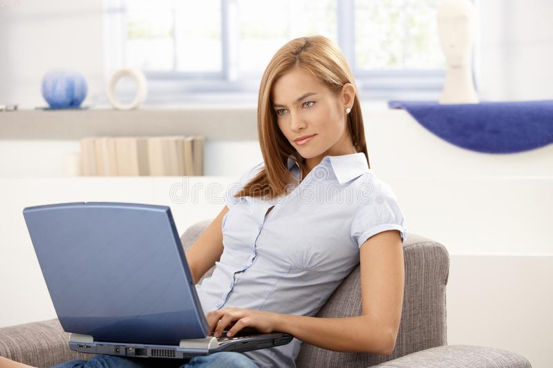 Download Attractive Female Working At Home Using Laptop Stock Image - Image: 18718831