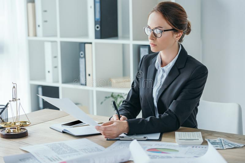 attractive financier working with documents at table stock photos