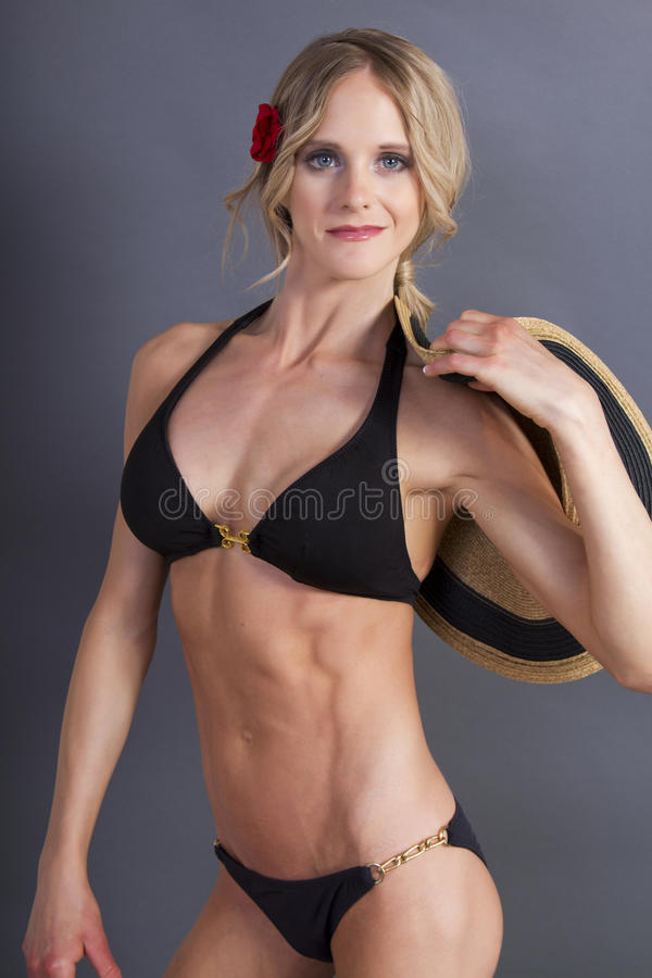 Attractive fit young blonde female in a bikini top royalty free stock photos