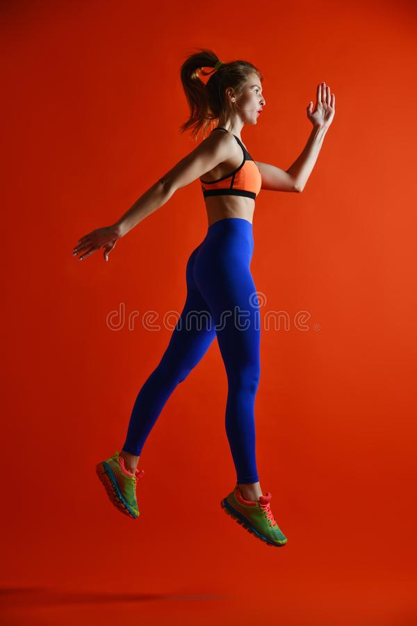 Attractive fitness girl in sportwear jumping royalty free stock photos