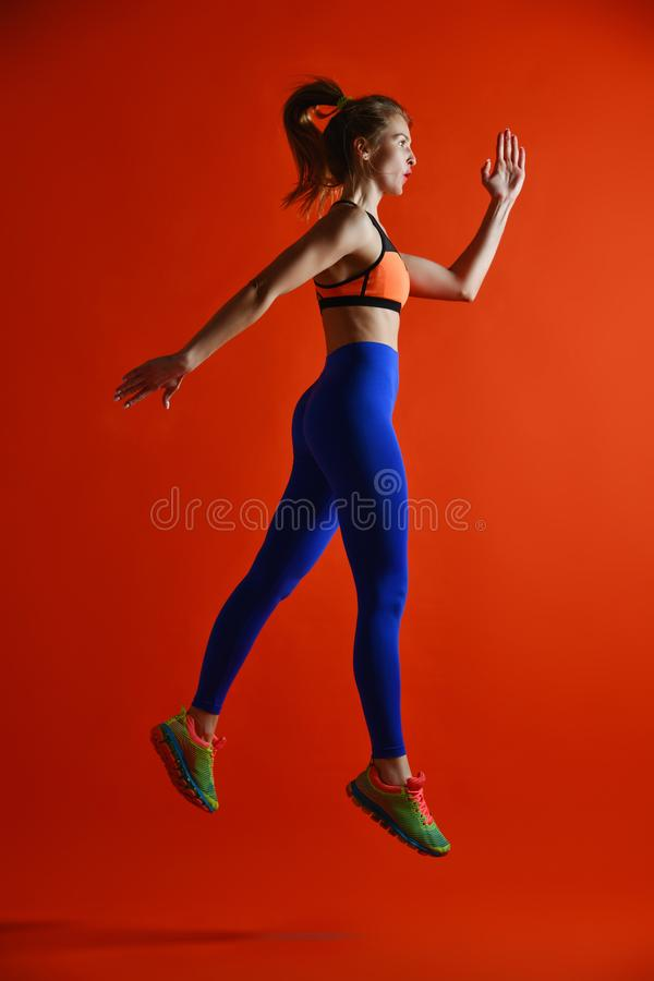 Attractive fitness girl in sportwear jumping royalty free stock photo