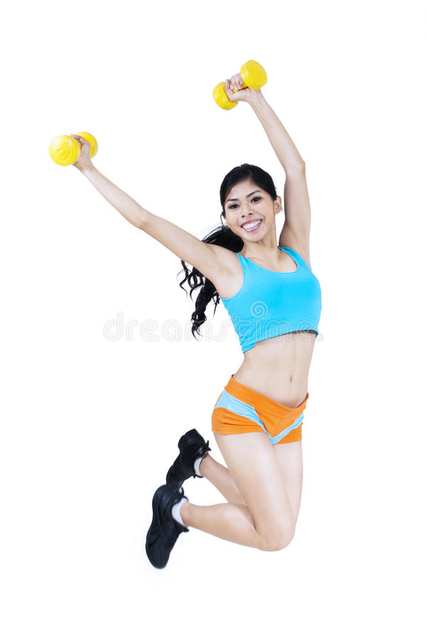 Download Attractive Fitness Woman Jumping With Dumbbell Stock Photo - Image: 33654732