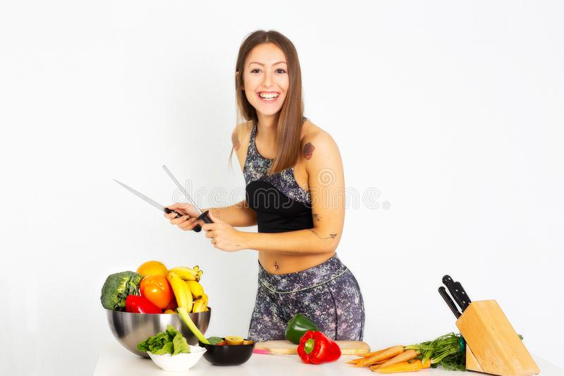 Attractive fitness woman, trained female Fit power athletic confident young woman bodybuilder doing exercises , Organic Food. Attractive fitness woman with a stock images