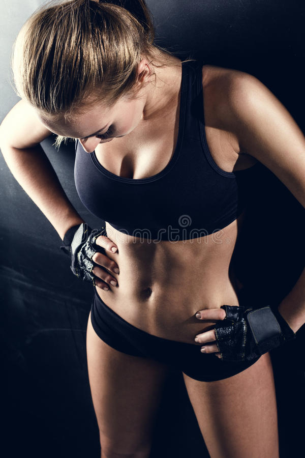 Attractive fitness woman, trained female body. Lifestyle portrait, caucasian model royalty free stock photography