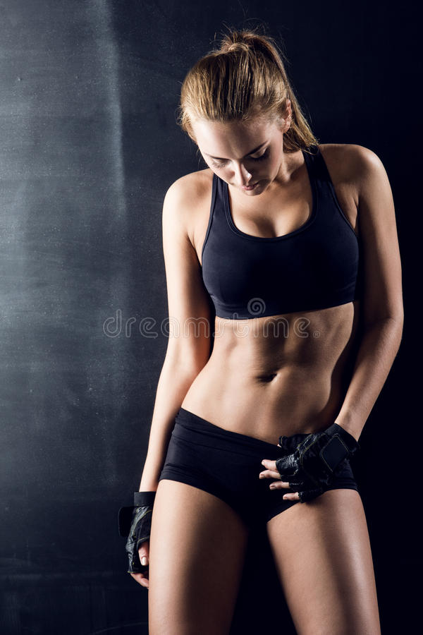 Attractive fitness woman, trained female body. Lifestyle portrait, caucasian model stock photography