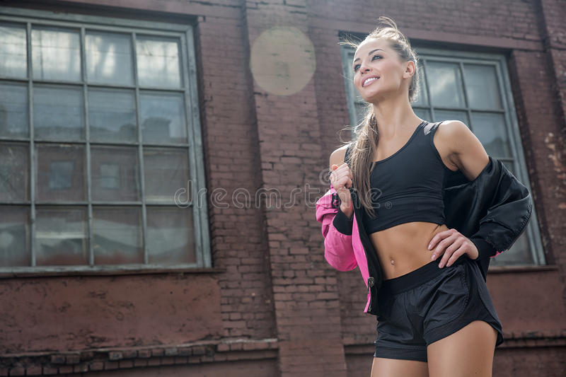 Attractive fitness woman, trained female body, lifestyle portrait, caucasian model stock photos