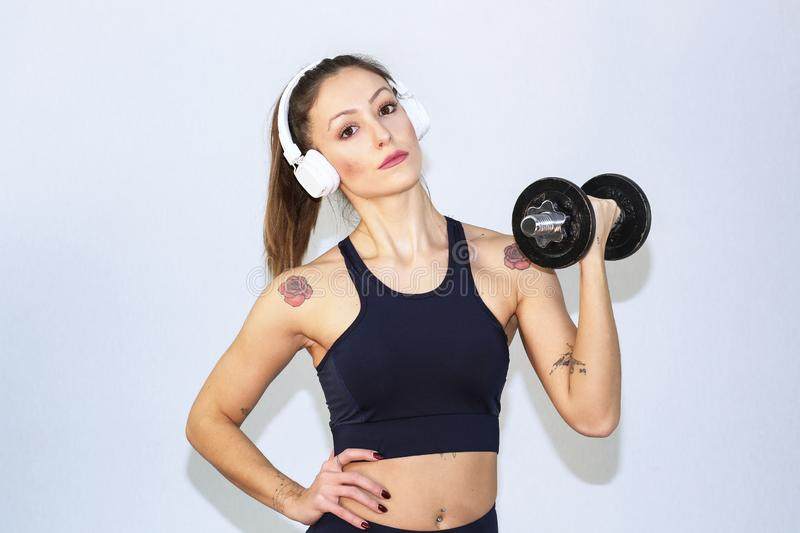 Attractive fitness woman, trained female body,Attractive fitness woman with top and mp3 player, caucasian lifestyle portrait, cauc stock images
