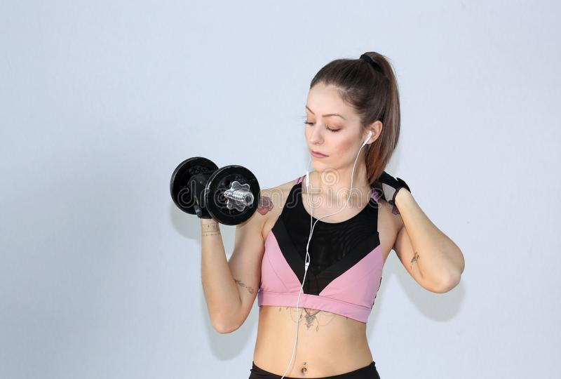 Attractive fitness woman, trained female body,Attractive fitness woman with top and mp3 player, caucasian lifestyle portrait, cauc royalty free stock image