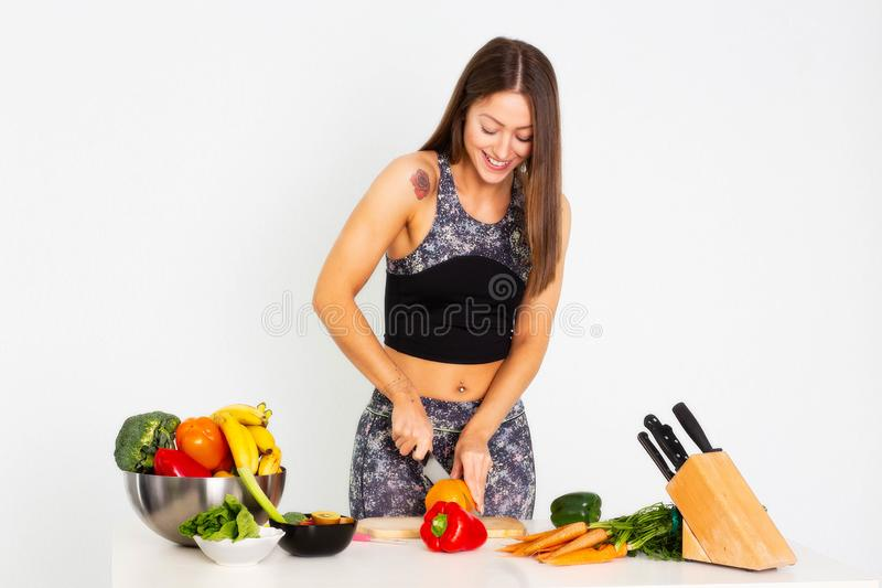 Attractive fitness woman, trained female Fit power athletic confident young woman bodybuilder cuting orange, Organic Food. stock photo