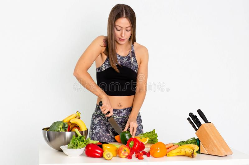 Attractive fitness woman, trained female Fit power athletic confident young woman bodybuilder cuting orange, Organic Food. stock photos