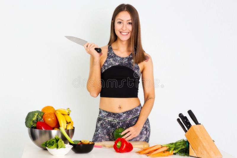 Attractive fitness woman, trained female Fit power athletic confident young woman bodybuilder doing exercises , Organic Food. Portrait Of Young Smiling Woman stock image