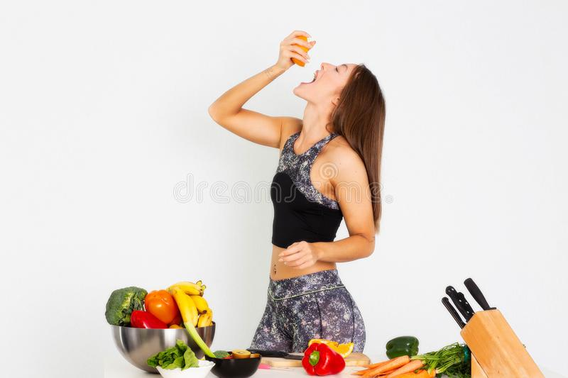Attractive fitness woman, trained female Fit power athletic confident young woman bodybuilder eating orange, Organic Food. royalty free stock photo