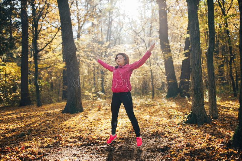Attractive fitness woman. Workout outdoors. Healthy lifestyle royalty free stock photos