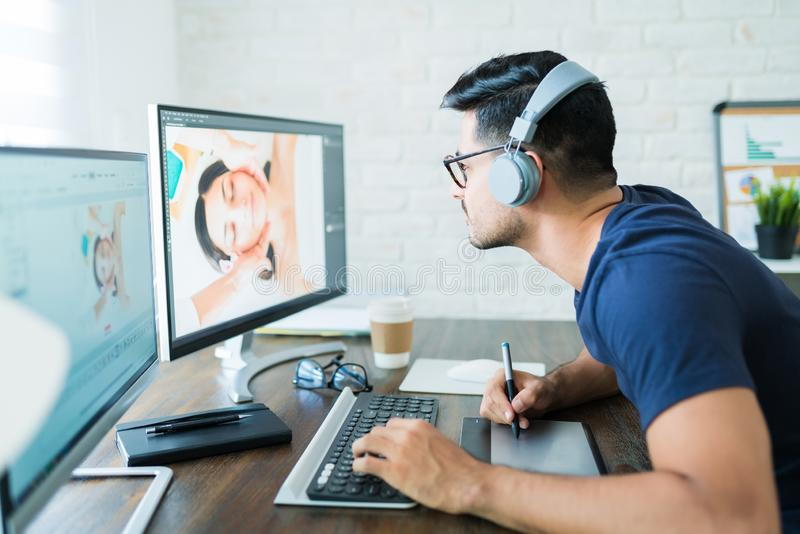 Attractive Freelancer Editing While Working At Home stock photography