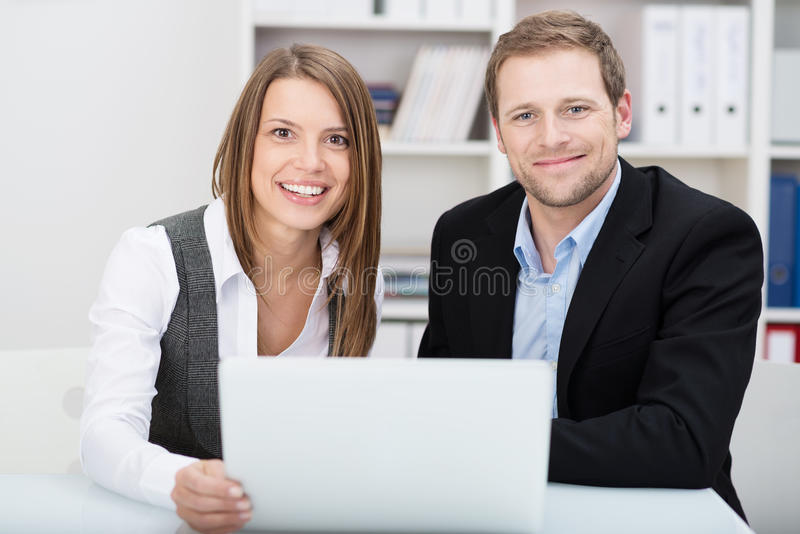 Attractive friendly young businessman and woman royalty free stock photos