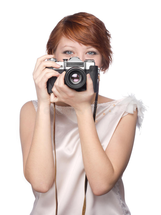Attractive funny girl with a camera over white royalty free stock images
