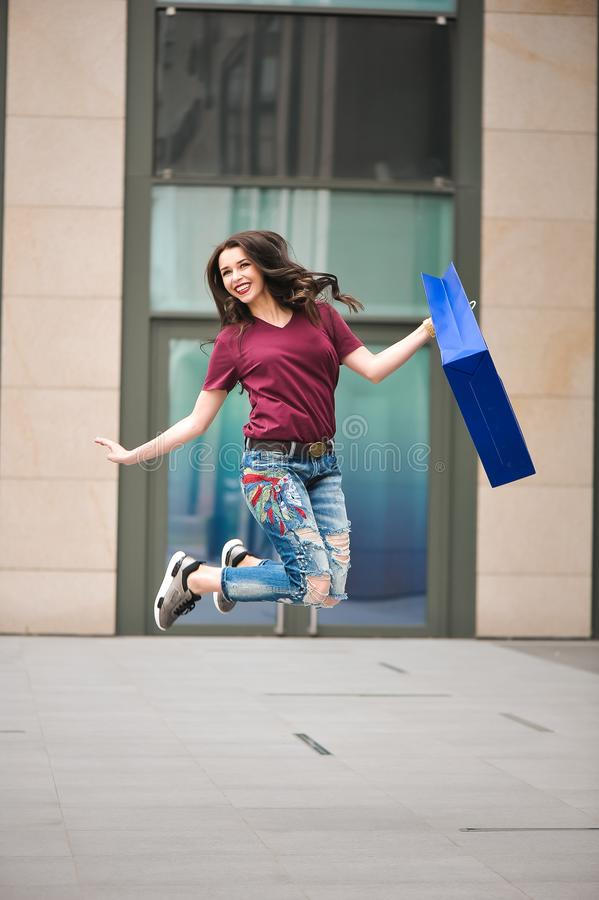 Attractive girl with Bags in her hand. Woman and shopping. royalty free stock images