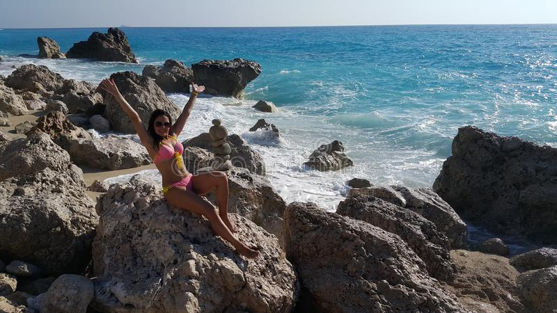Attractive girl on the beach stock photos