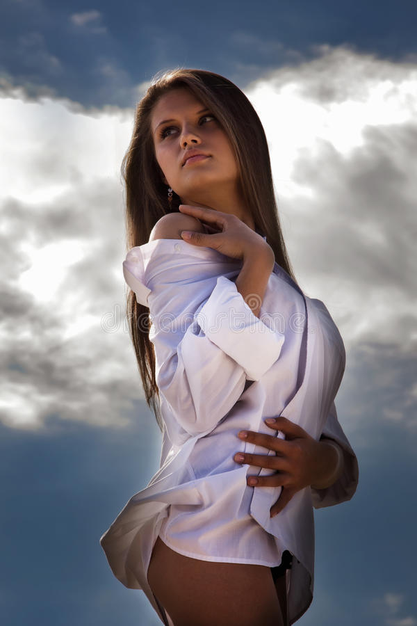 Download Attractive Girl On A Blue Sky Background Stock Photo - Image: 26720868