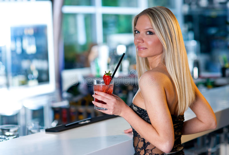 Attractive girl with cocktail stock image
