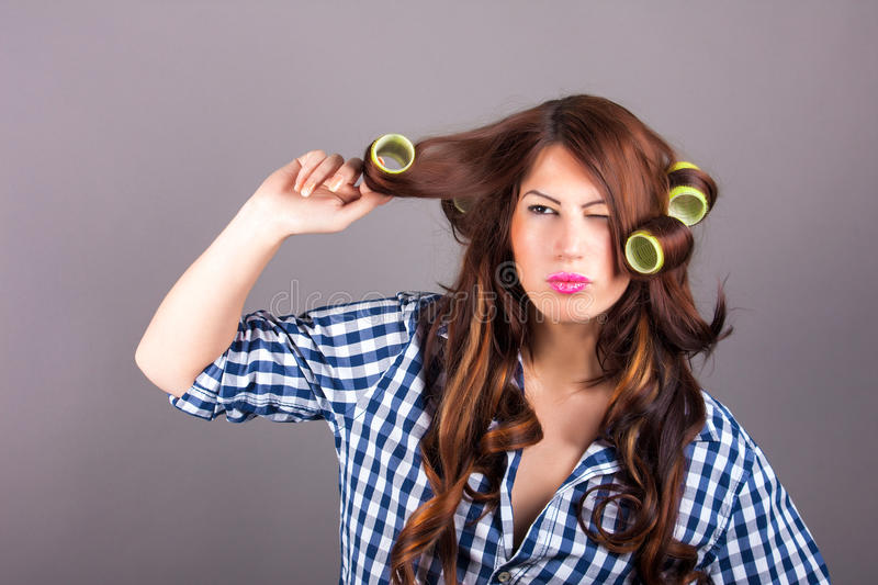 Attractive girl with curlers royalty free stock image