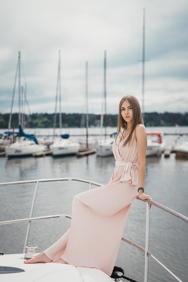 Attractive girl in a dress on a boat royalty free stock image