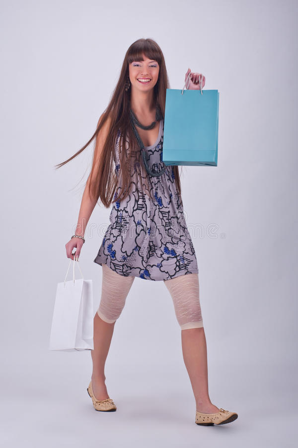 Download Attractive Girl Enjoys A Large Number Of Purchases Stock Image - Image of model, shopaholic: 23962045