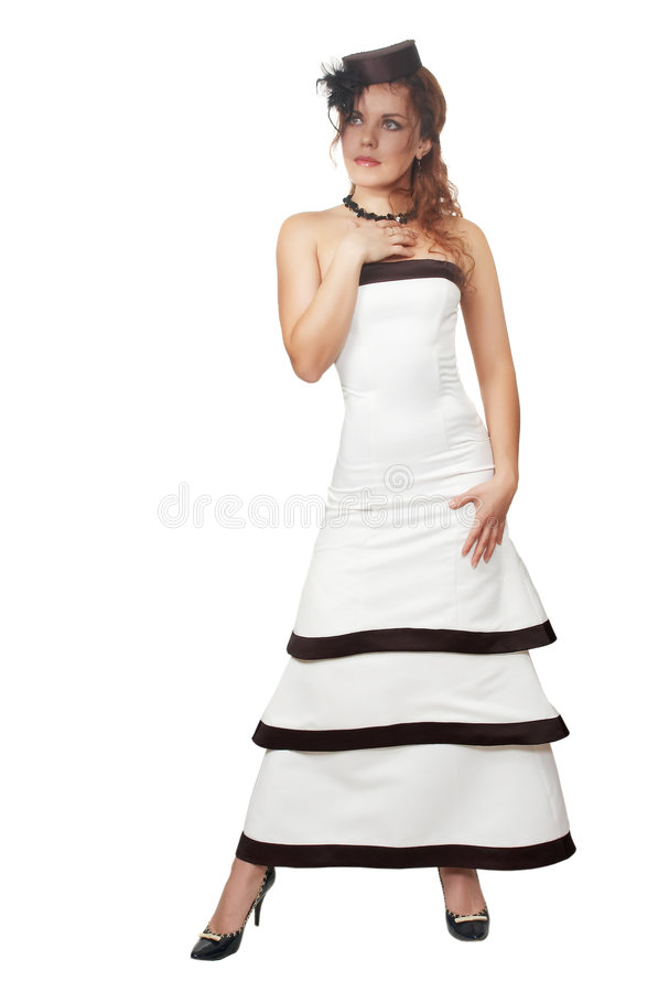 Attractive girl in an evening dress and black veil. The young beautiful girl in a white smart evening dress stock photo