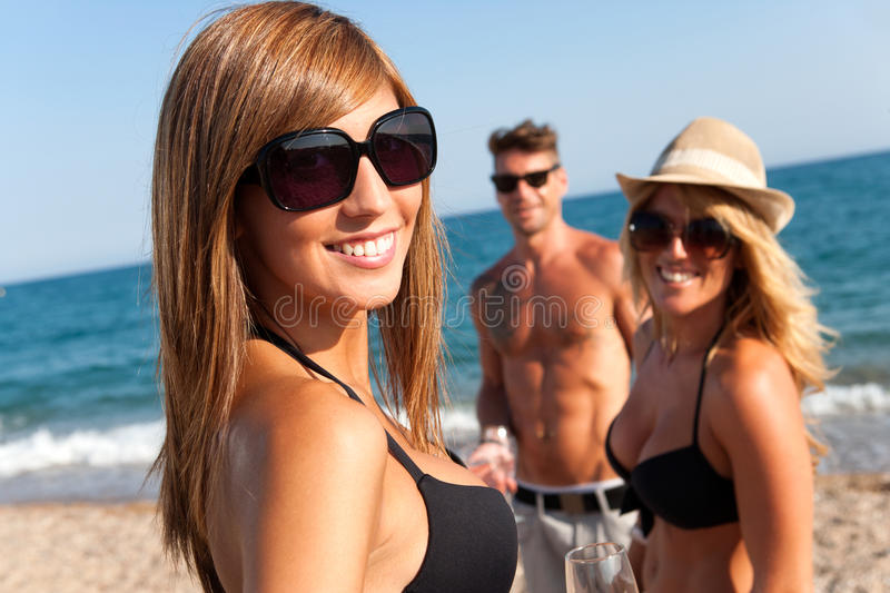 Download Attractive Girl With Friends On Beach. Stock Image - Image: 26766971