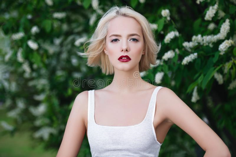 Attractive girl in garden royalty free stock images