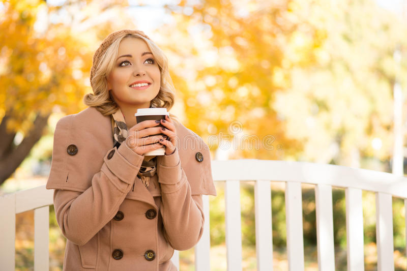 Attractive girl getting refreshment with coffee royalty free stock photos