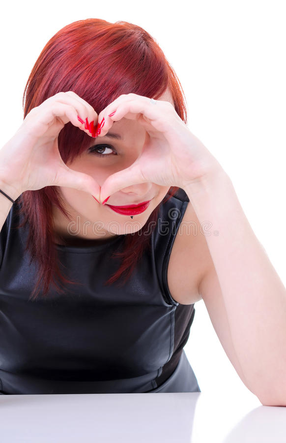 Attractive girl with hands heart
