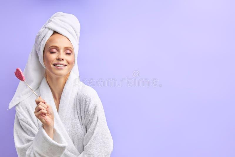 Happy caucasian woman with lollipop stock photo