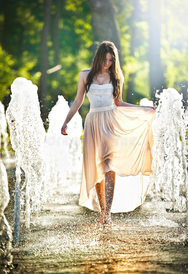 Free Attractive Girl In Playing In Water Fountain Stock Image - 25315661