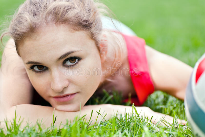 Download Attractive Girl Lay On Grass Stock Photo - Image: 14689406