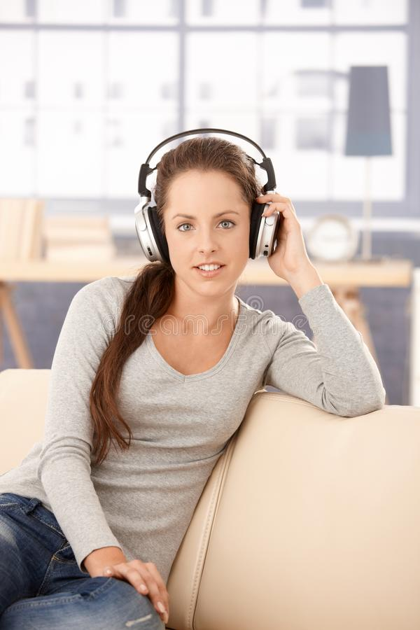 Download Attractive Girl Listening To Music At Home Smiling Royalty Free Stock Photos - Image: 17097688