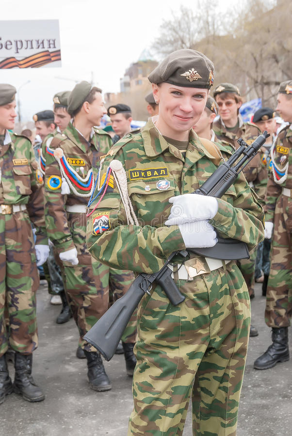 Attractive girl in military uniform before parade stock images