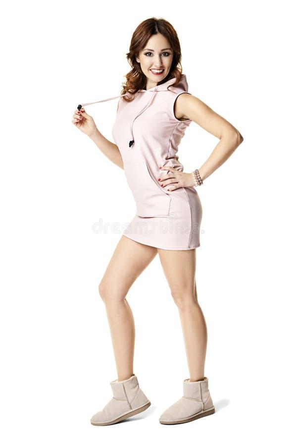 Attractive girl in pink mini dress. Studio shot of attractive girl in pink mini dress royalty free stock photos