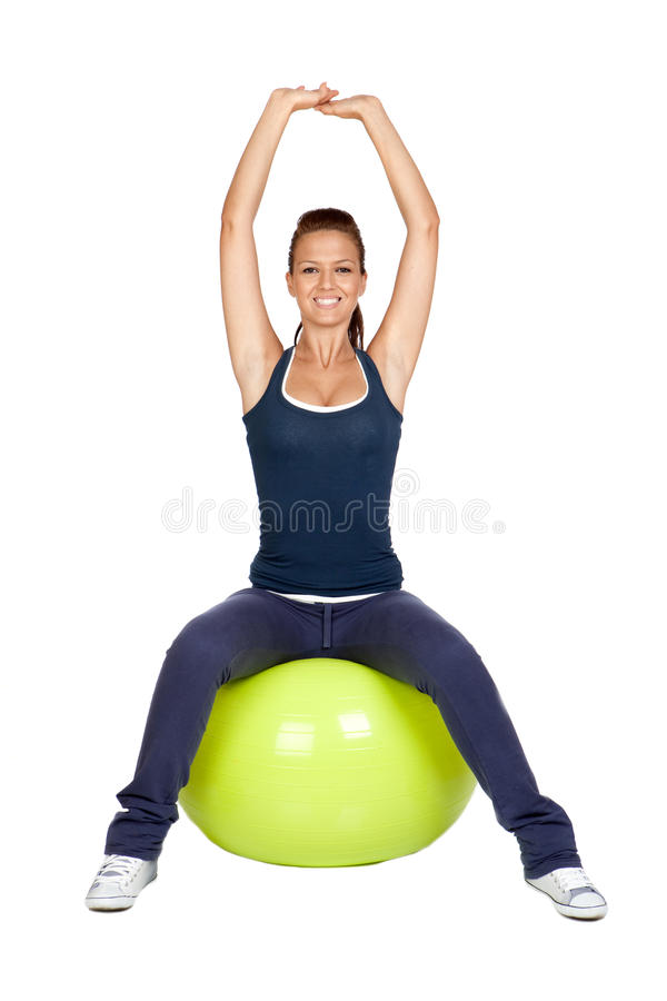 Attractive girl practicing pilates