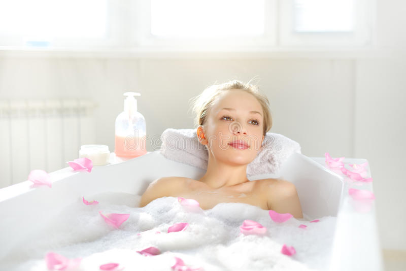 Attractive girl relaxing in bath royalty free stock photo