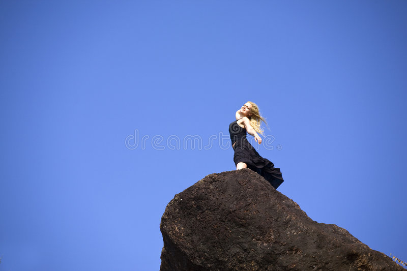 Download Attractive girl on rock stock image. Image of girl, pose - 7592543