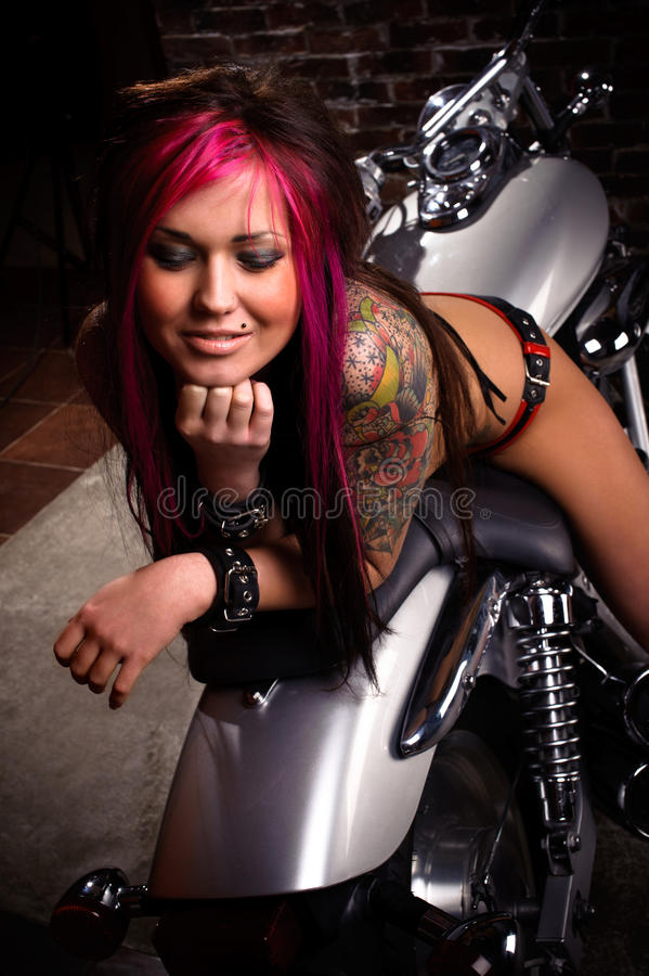 Attractive girl sitting on a chopper stock photos