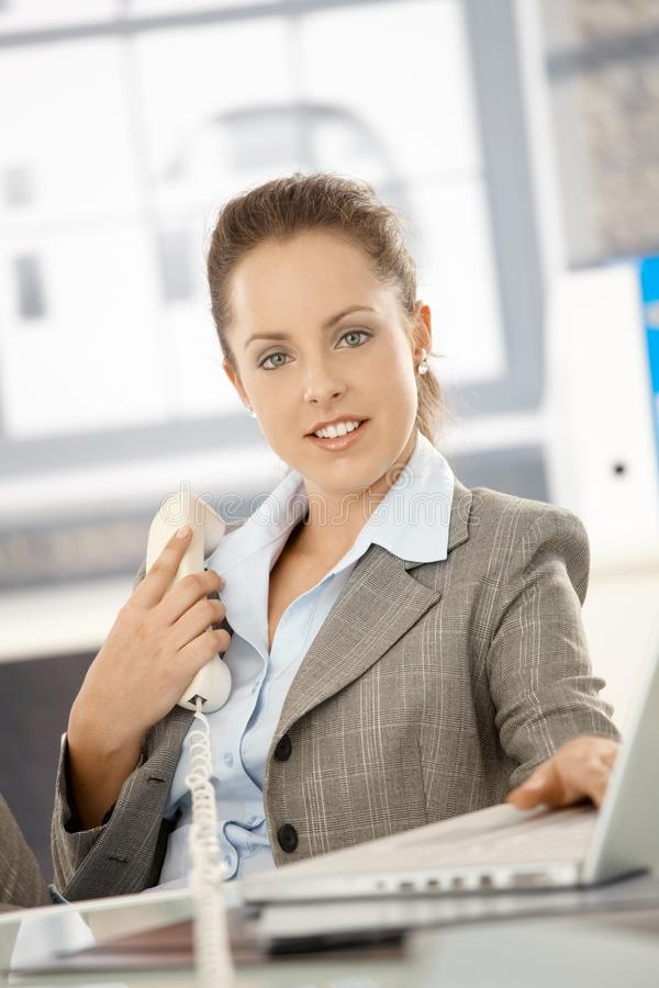 Download Attractive Girl Sitting By Desk In Bright Office Stock Photo - Image: 17097736