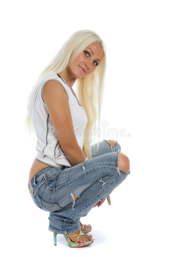 Attractive girl with tattered jeans. Sit on floor stock photos