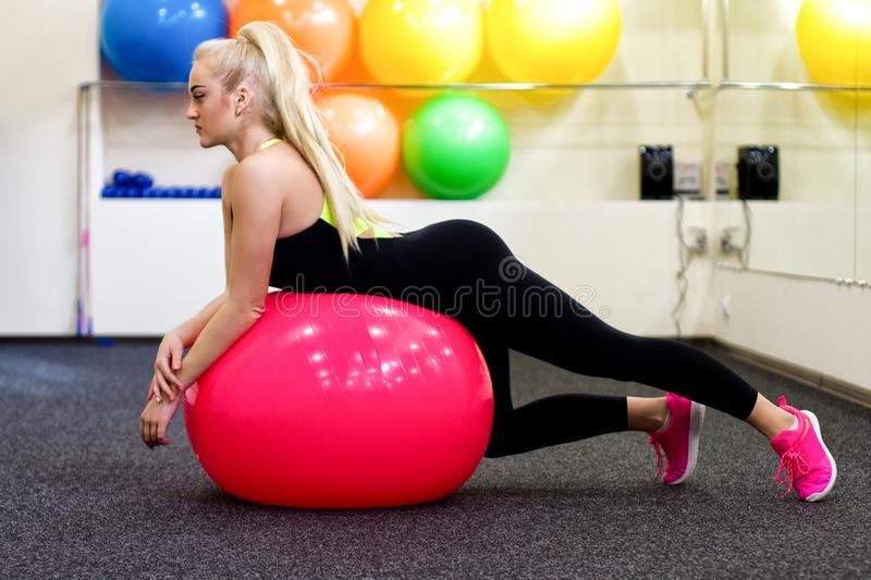Attractive girl training in gym royalty free stock image